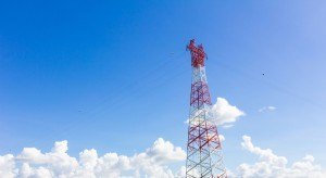 Tower Ventures red and white Cellular Towers